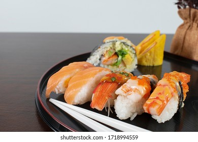 Shushi, Japanese food, placed on a black tray