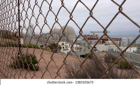 The shut down San Onofre nuclear power plant seen through security fence. Many questions remain about its decommission. Taken San Onofre, CA / USA on April 28, 2019.