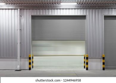 Shutter door or roller door and concrete floor outside factory building  for industrial background.