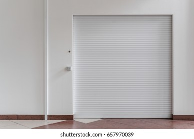 Shutter door or rolling door white color, in the new shopping center