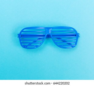 Shutter shades sunglasses on a blue background