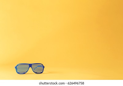 Shutter shades sunglasses on a yellow background