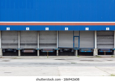 Shuttered and abandonded blue industrial loading dock.