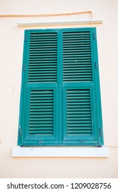 Shuttered windows in Gibraltar. Gibraltar is a British Overseas Territory located on the southern tip of Spain.