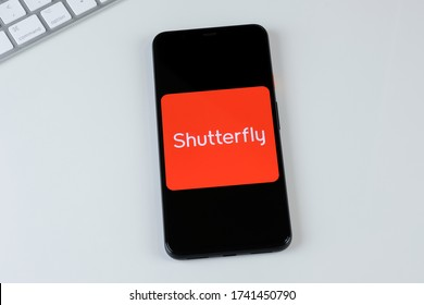 Shutterfly app logo on a smartphone screen. Manhattan, New York, USA May 2, 2020.