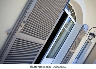 Shutters and windows on a terrace