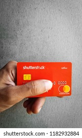 Shutterstock Branded Payoneer Mastercard On Textured Background
