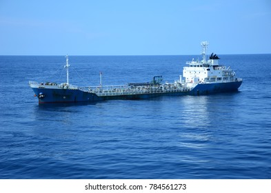Shuttle tanker floating on blue sea waiting to transfer MGO
