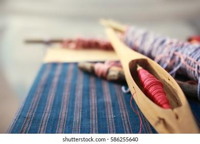 Shuttle weaving