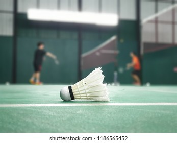 shuttlecock on badminton court