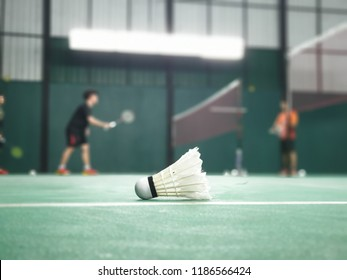 Shuttlecock on badminton court with competition of badminton background