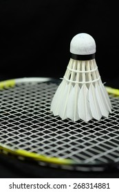 Shuttlecock and racket badminton with black background