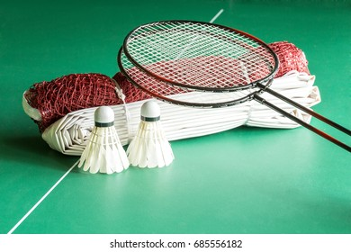 Shuttlecock  racket and net  for badminton game  on green table