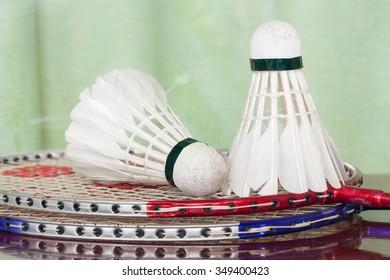 Shuttlecocks and badminton racket.