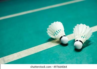 Shuttlecocks on badminton playing court