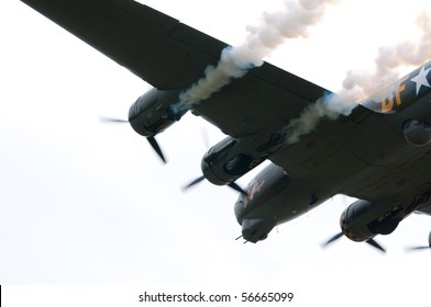 """SHUTTLEWORTH, BEDFORDSHIRE - JULY 4: Boeing B-17G Flying Fortress """"Sally B"""" (as Memphis Belle) in flight at the Air Display on July 4, 2010 at Shuttleworth, Old Warden Park, Bedfordshire, UK."""