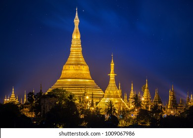Shwedagon pagoda with blue night sky background in Yangon, Myanmar, Asia