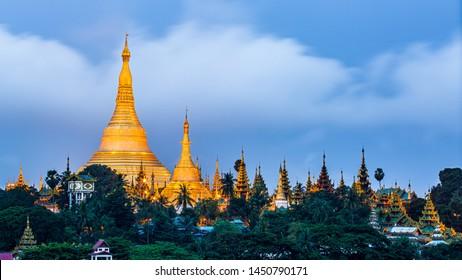 Shwedagon Pagoda at morning in Yagon City with blue sky background, Shwedagon Pagoda is beautiful pagoda in Southeast Asia, Yangon, Myanmar.