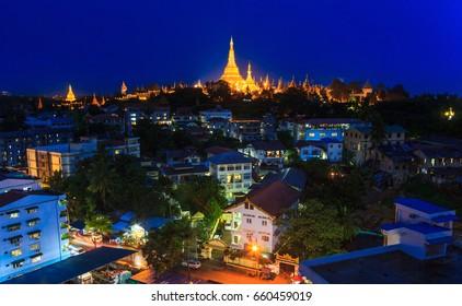 Shwedagon Pagoda Outstanding Above Yangon Cityscape Of Myanmar
