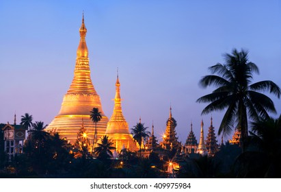 Shwedagon Pagoda view at sunrise in Yangon, Myanmar. The pagoda is situated on Singuttara Hill and dominates the Yangon skyline
