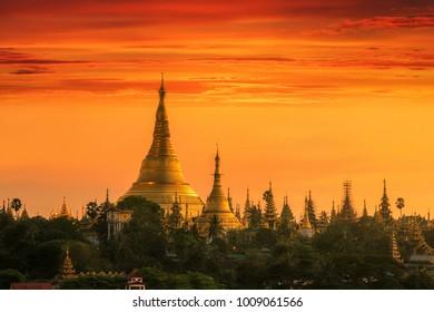 Shwedagon pagoda in Yangon city with sunset and temple, Myanmar