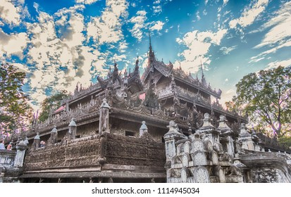 the Shwenandaw Monastery, Mandalay, Myanmar. The monastery is built entirely of teak wood
