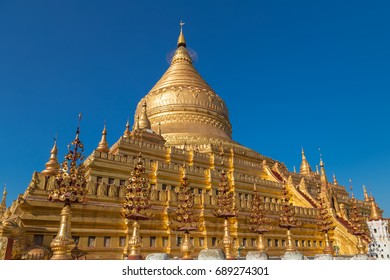 Shwezigon pagoda is the only fully coated by gold bell shaped Buddhist stupa in Bagan, Myanmar, a prototype for all Burmese stupas. Shwezigon paya enshrines Buddha tooth and bone relics.