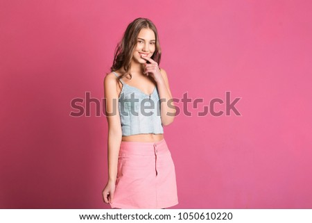 16479a4cd5b Shy but beautiful smiling girl wearing brandy stylish clothes - jeans top  and pink skirt standing