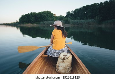 Shy canoe girl hiding her look back