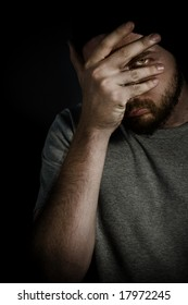 Shy Embarrassed Man Covering Face with Hand
