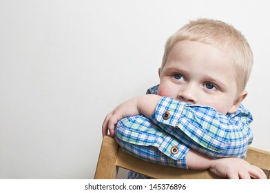 Shy and frightened little boy