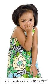 shy little asian girl smiling over white
