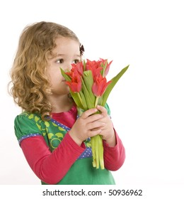 Shy little girl with a flower surprise
