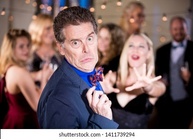 Shy man aggressively pursued by woman at a party