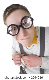 Shy nerd in funny glasses. Smiling and looking at camera. Holding his strap. High angle view, white background