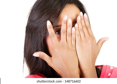 Shy woman peeking through covered face , isolated on white.