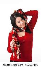 Shy young girl with red dress playing with her scarf