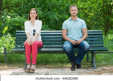 Shy Young Man And Woman  On First Date In Park