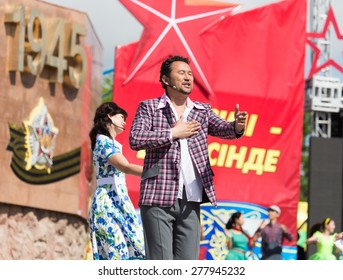 SHYMKENT city, KAZAKHSTAN MAY 9, 2015: Gala concert with the participation of theater actors, Victory Day, in memory of the soldiers of the Great Patriotic War.