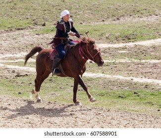 Shymkent, KAZAKHSTAN - 22 March 2017: Celebration of the Kazakh holiday NARIYZ. Archery from a horse