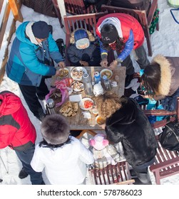 Shymkent, KAZAKHSTAN - February 5, 2017: a picnic on the ski resort Tausamaly