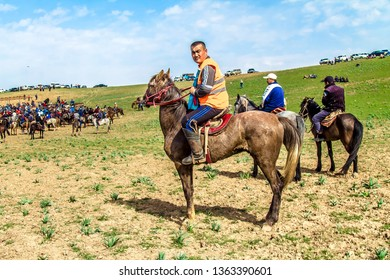 Shymkent, Kazakhstan - March 17, 2019;Nomad riders train on horseback in the steppes of Kazakhstan.Kazakh traditions. Folk entertainment. Kazakh national game Kokpar.