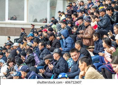"""Shymkent, Kazakhstan, March 22, 2017: Mass walks at the city hippodrome in honor of the holiday of the spring equinox """"Nauryz"""". Horse competitions """"Cockpar"""".The audience."""