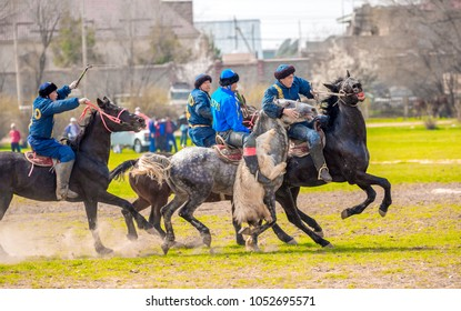 Shymkent, Kazakhstan, March 22, 2018: Equestrian traditional national competitions Kokpar, Kazakh Muslims and traditions, tests of young dzhigits in honor of the holiday of the spring equinox Nauryz.