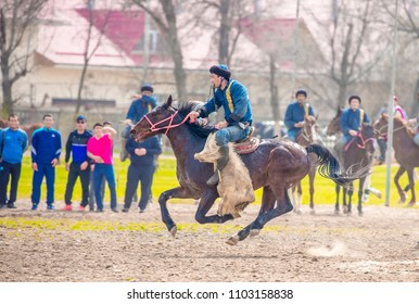 "Shymkent, Kazakhstan, March 22, 2018: Traditional entertainment ""Kokpar"" in honor of the national holiday of the spring equinox ""Nauryz"". Kazakh Muslim traditions."