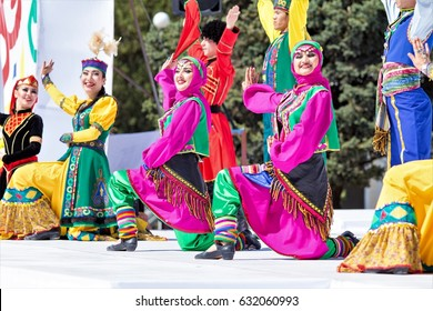 SHYMKENT, KAZAKHSTAN - MAY 1 2017: Dancers in the national costumes of the peoples of Kazakhstan. On May 1, Kazakhstan marks the Day of Unity of the People
