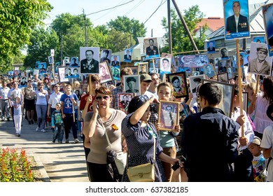 "Shymkent, Kazakhstan, - May 9, 2017: Procession ""Immortal Regiment"" in honor of the Victory of the Red Army and the Soviet people in the Great Patriotic War of 1941-1945. Mass folk festivities."