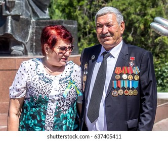 """Shymkent, Kazakhstan, - May 9, 2017: Procession """"Immortal Regiment"""" in honor of the Victory in the Great Patriotic War 1941-1945. Mass walks in the park."""