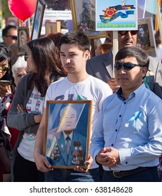 Shymkent, KAZAKHSTAN - May 9, 2017: Immortal regiment. Folk festivals of people. The feast of the victory of the Red Army and Soviet people in the Great Patriotic War of 1941-1945
