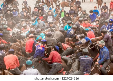 Shymkent, Kazakhstan, November 5, 2018: Nomad horse riders play horseback horseback, known as Kokpar, in Kazakhstan steppes. Kazakh Muslims and traditions.